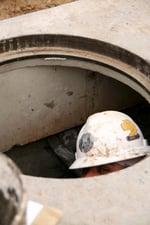 Hacker in manhole