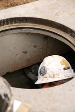 Hacker in manhole